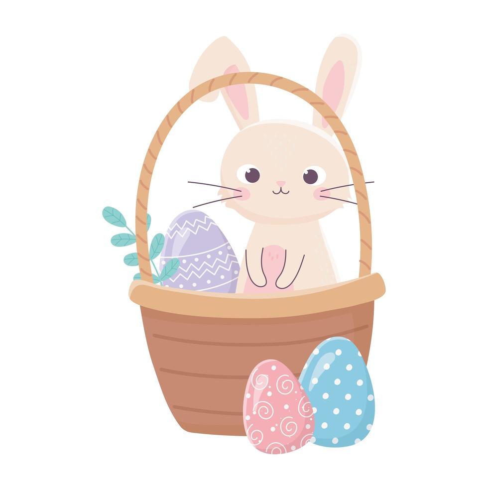 lycklig påskdag, kanin i korg med ägg lämnar gräs vektor