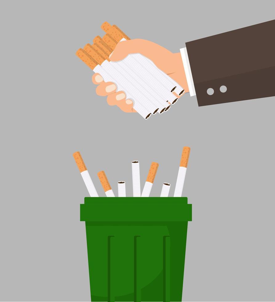 hand kasta cigaretter i papperskorgen vektor