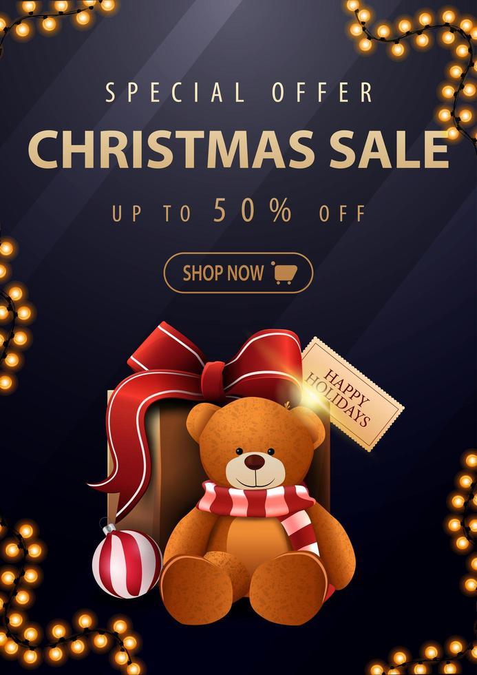 Sonderangebot, Weihnachtsverkauf, bis zu 50 Rabatt, schönes dunkelblaues Rabattbanner mit goldenen Buchstaben und Geschenk mit Teddybär vektor