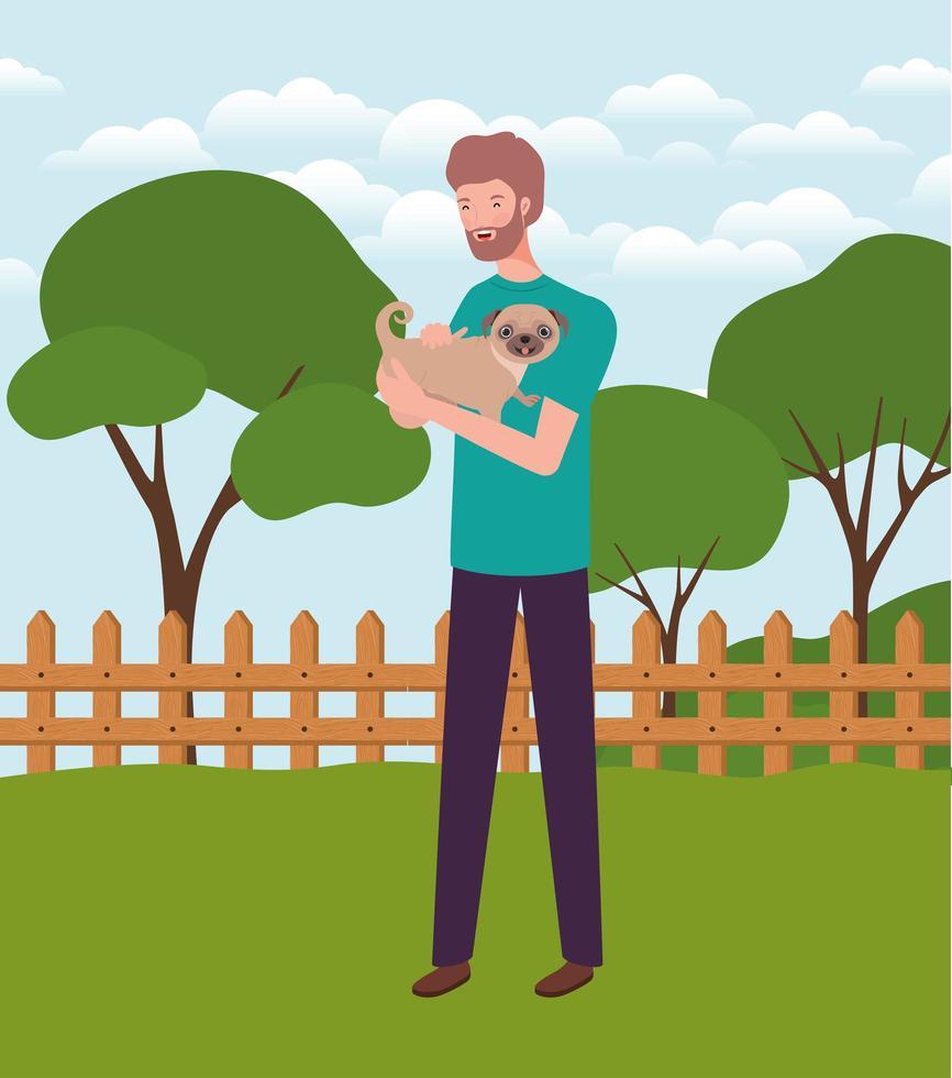 junger Mann, der niedliches Hundemaskottchen im Lager anhebt vektor
