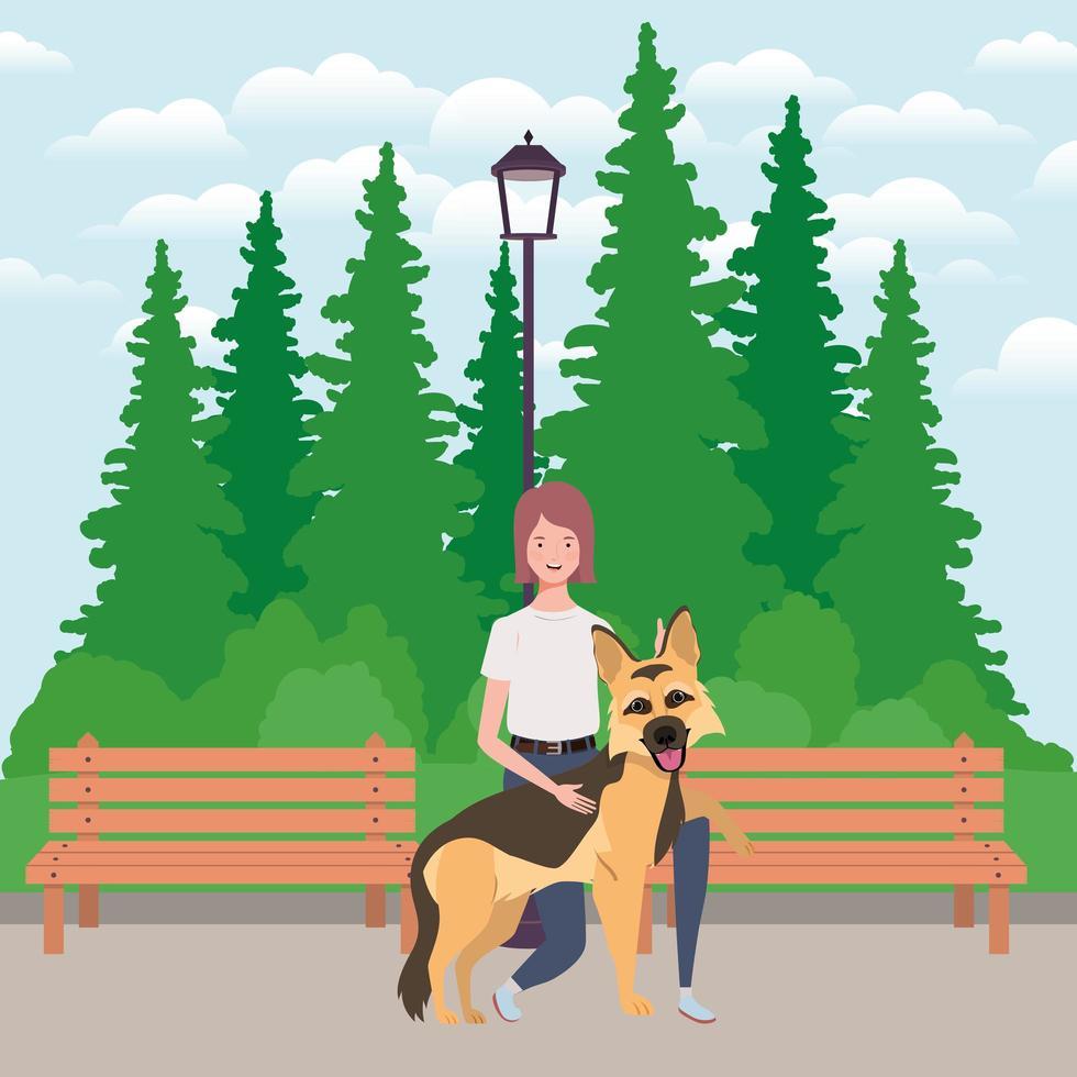 junge Frau mit niedlichem Hundemaskottchen im Park vektor