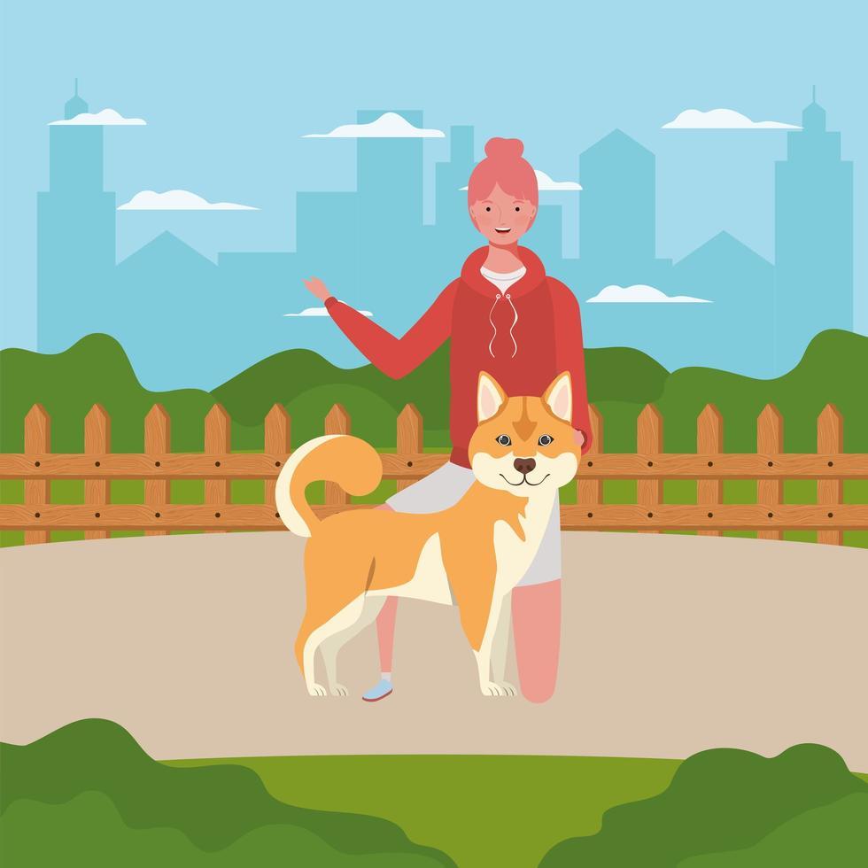 junge Frau mit niedlichem Hund im Feld vektor