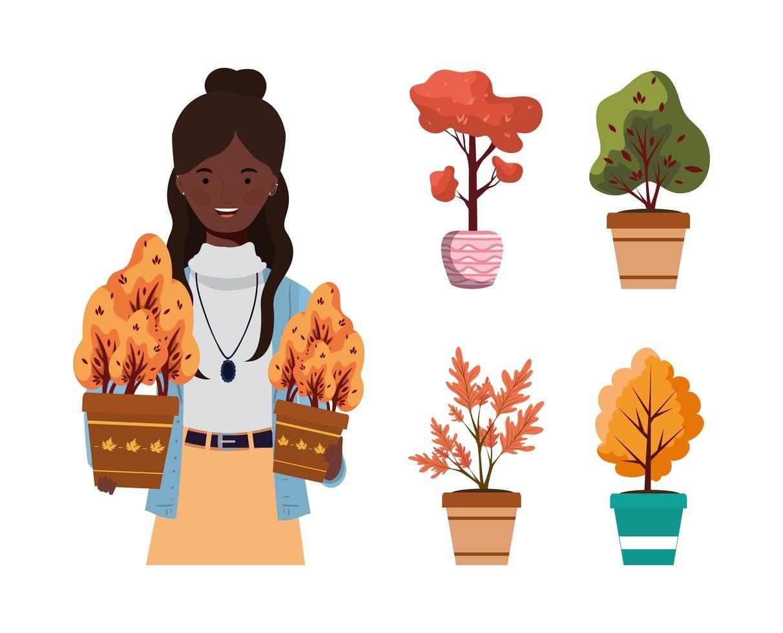 afro kvinna med höstväxter i keramiska krukor vektor