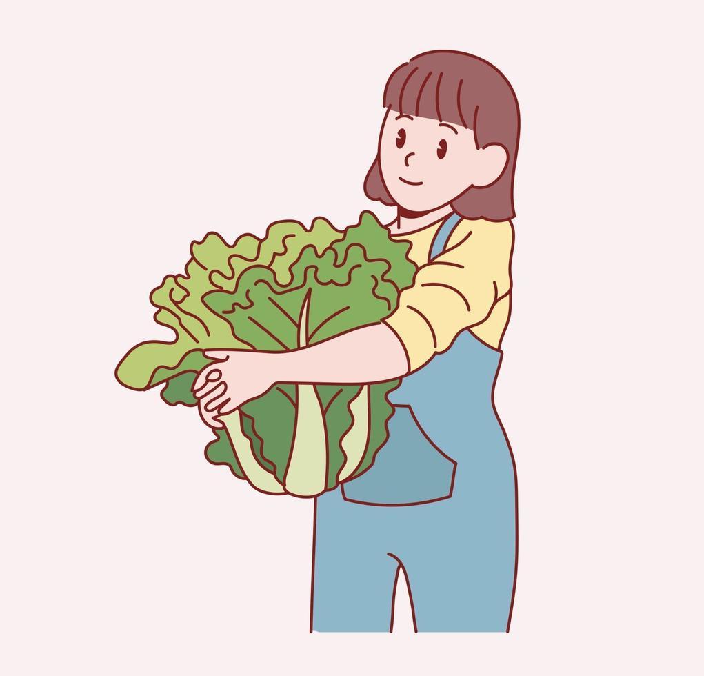 en söt liten flicka står och håller en stor kål. handritade stilvektordesignillustrationer. vektor
