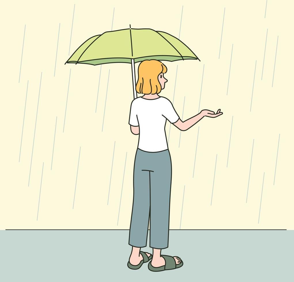 en kvinna bär ett paraply och sträcker ut handen i regnet. handritade stilvektordesignillustrationer. vektor