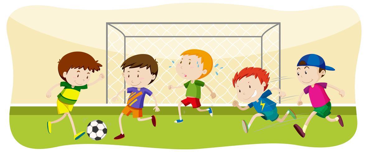 Pojke spelar fotboll på fältet vektor