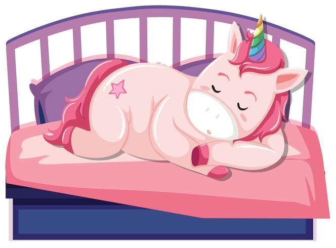 En enhörning sover på sängen vektor
