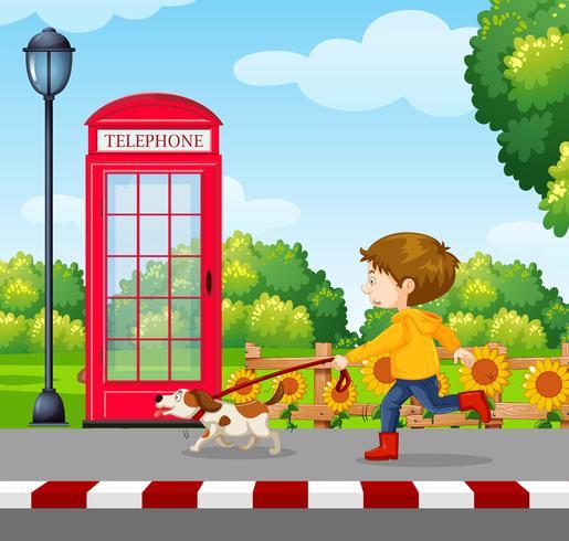 En pojke som går en hund vektor