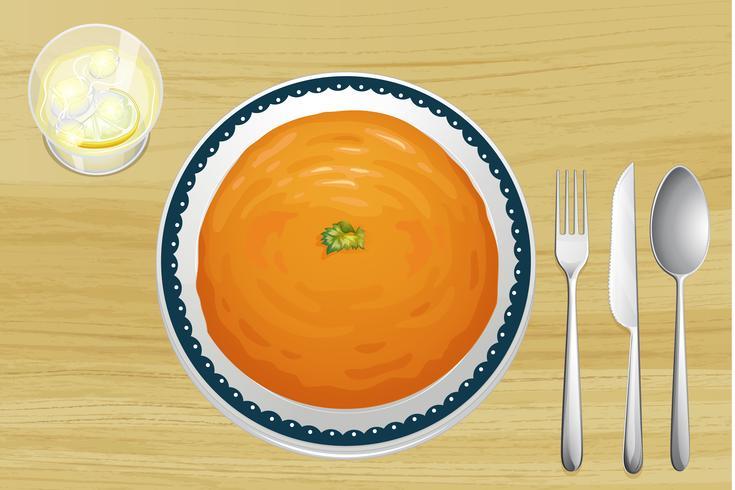 Eine Orangensuppe auf einer Platte vektor