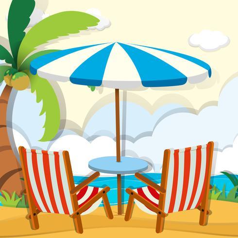 Stühle und Sonnenschirm am Strand vektor