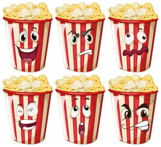 Olika ansiktsuttryck på popcorn koppar vektor