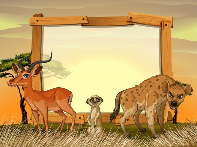 Rahmendesign mit wilden Tieren im Feld vektor