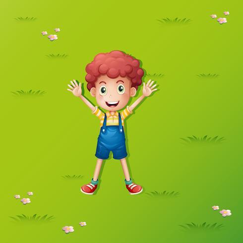 Kleiner Junge, der auf dem grünen Gras liegt vektor
