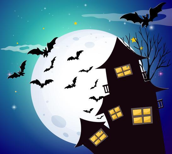 Halloween-Nacht mit Fledermäusen und Geisterhaus vektor