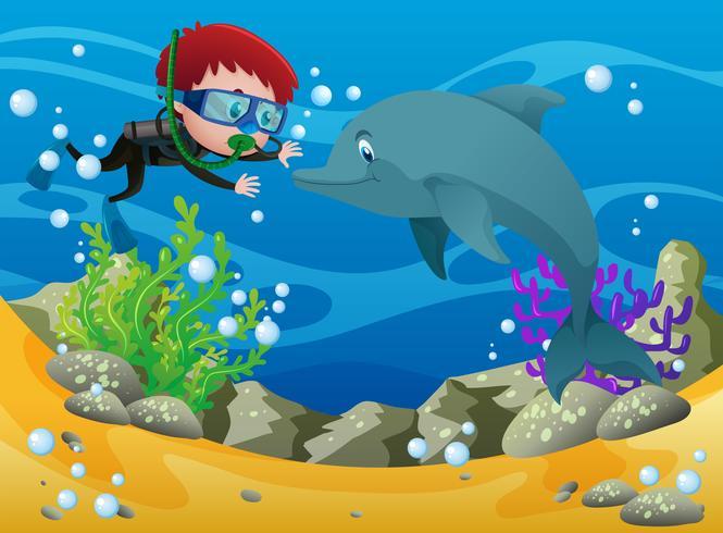 Pojke dykning med delfin under vattnet vektor