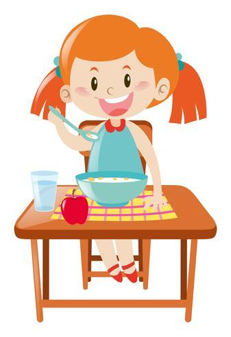 Mädchen beim Essen am Tisch vektor