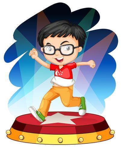 Liten pojke dansar på scenen vektor