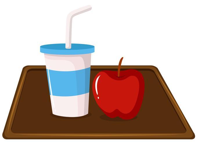 Apple und ein Milchshake auf Tablett vektor
