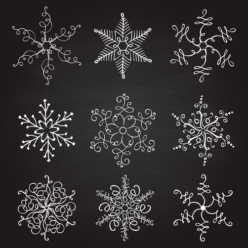 uppsättning av nio vintage vektor illustration christmas snöflingor på tavlan bakgrund. blomstra kalligrafiska handgjorda
