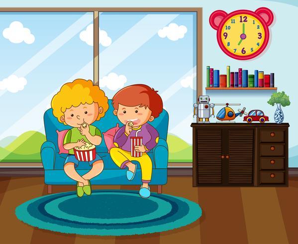 Två pojkar äter mellanmål i vardagsrummet vektor