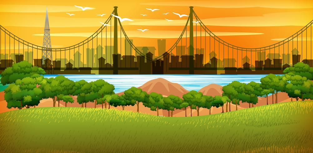 Bakgrundsscen med stad vid solnedgången vektor
