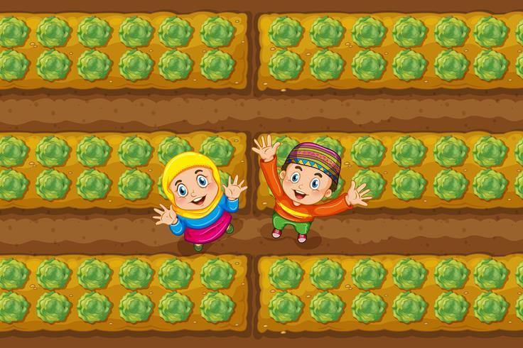 Två muslimska barn i grönsaksgården vektor