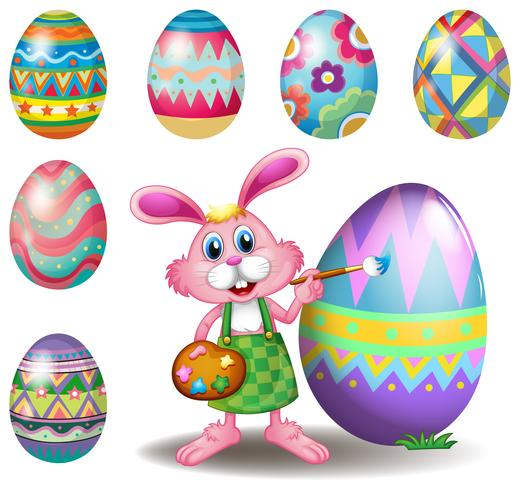 En kanin som målar äggen vektor