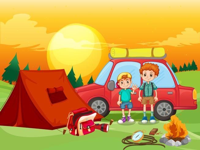 Pojkar camping ute på fältet vektor