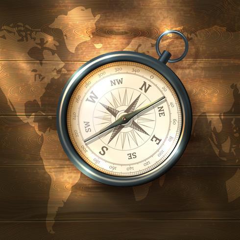 Kompass auf hölzernen Hintergrund vektor