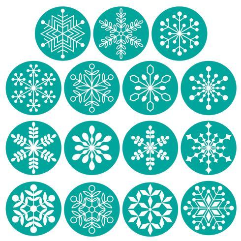 weiße Schneeflocken auf türkisblauen Kreisen vektor
