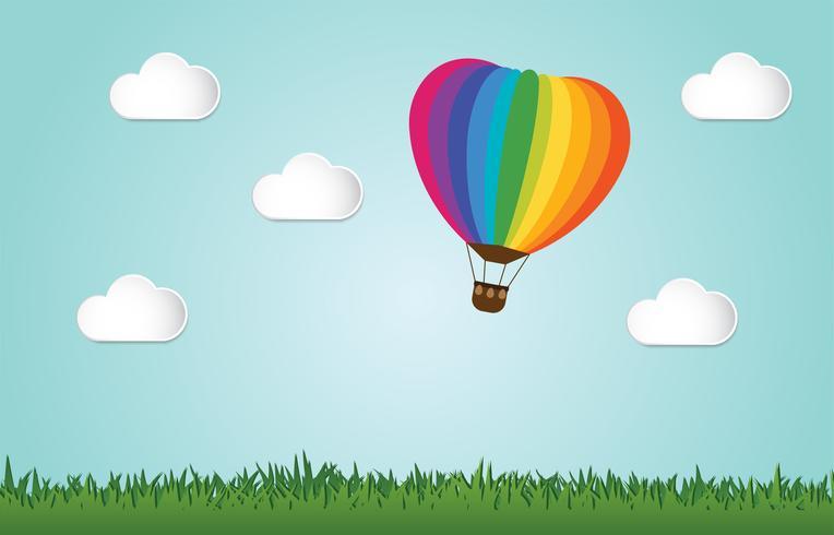 Origami gjorde färgstarkt varmluftsballongfluga över gräs. vektor