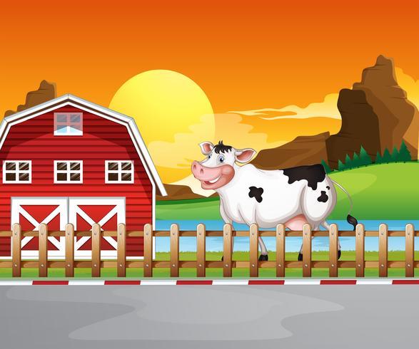 En ko bredvid trähushuset vektor