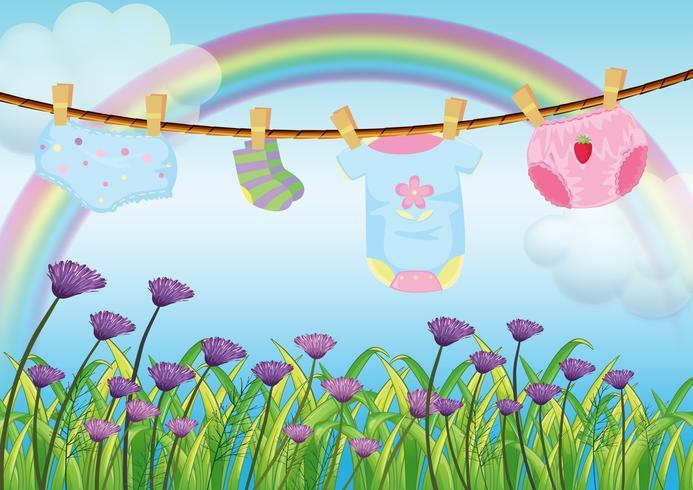 Ett barns kläder hänger över trädgården vektor