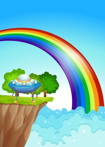 En tallrik på klippan och en regnbåge i himlen vektor