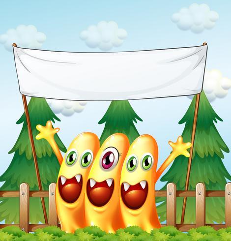 Drei Monster unter dem leeren Banner vektor