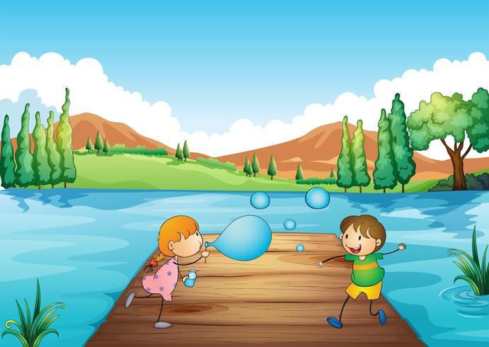 Ein junges Mädchen und ein Junge, die mit den Blasen spielen vektor