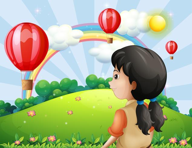 Ein Mädchen, das den Heißluftballon betrachtet vektor
