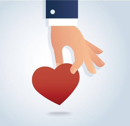 hand som håller den röda hjärtat vektorn vektor