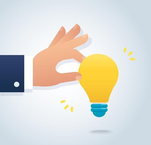 hand som håller en glödlampa vektor