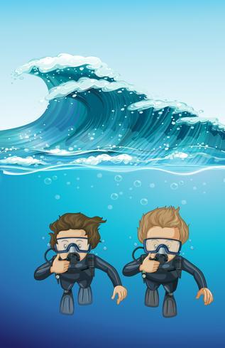 Två dykare under havet vektor