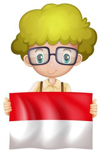 Ein indonesischer Junge mit Flagge vektor