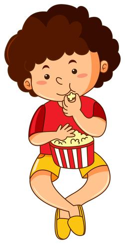 Glücklicher Junge, der Popcorn isst vektor
