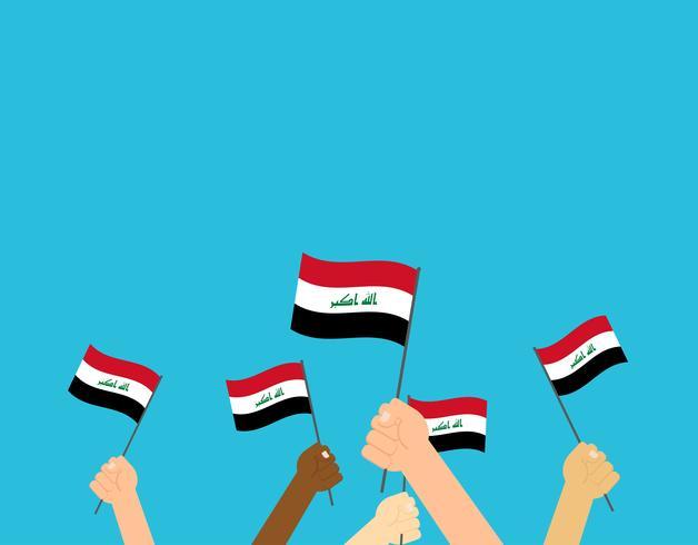 Vektor illustration händer som håller irak flaggor isolerade på blå bakgrund