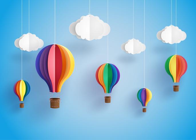färgglad varmluftsballong och moln. vektor