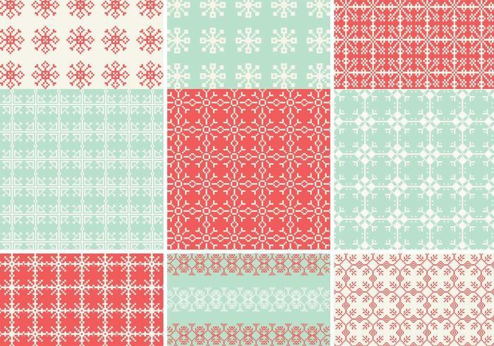 Pixelated Schneeflocke-Vektormuster-Satz vektor