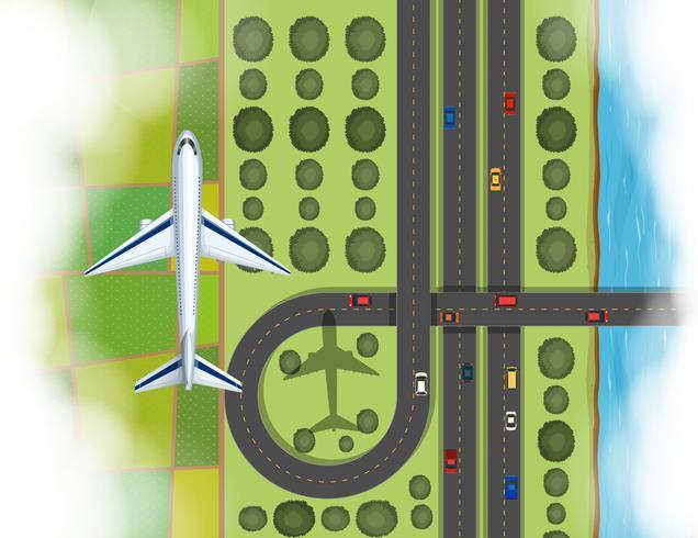 Flygplan av flygplan som flyger över marken vektor