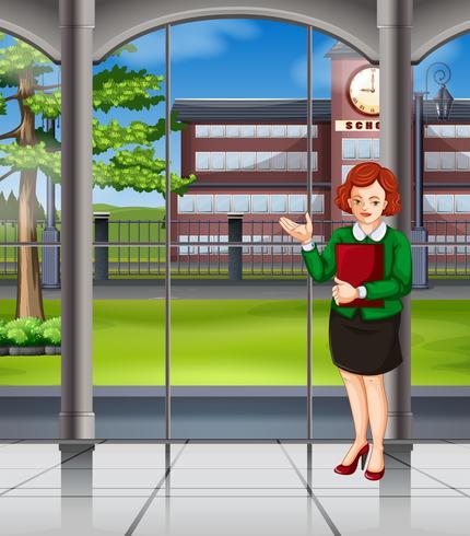 Kvinna står inne i skolan vektor