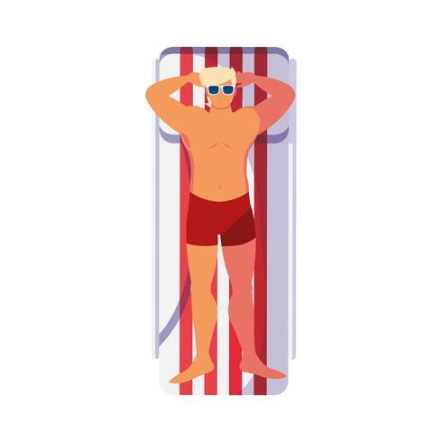 junger Mann mit Badeanzug in der Bräunungsmatte vektor