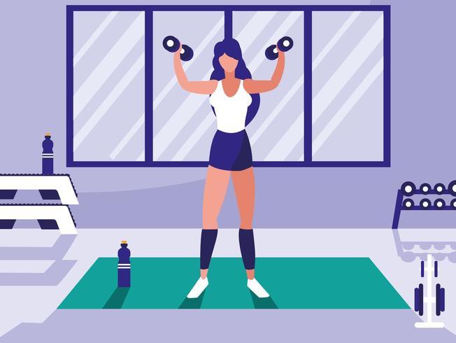 junge athletische Frau, die anhebende Dummköpfe in der Turnhalle vektor