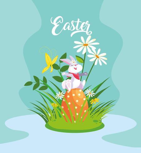 söt kanin med ägg av påsk i trädgården vektor